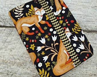 NWT reversible Bible cover, foxes and flowers, regular sized. Coordinating black print on reverse. Woodland animals and pretty flowers.