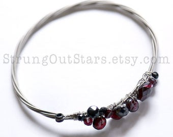 Temple of Love - Strung-Out guitar string bangle with garnet and black spinel