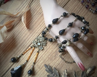 Rococo Gothic Skull Art Deco Jet Black Glass and Brass Lavalier Necklace by Louise Black