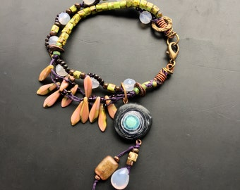 Handmade tribal rustic gypsy bracelet by Lori Lochner chartreuse and purple layering beaded glass bracelet