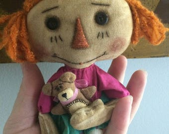 Small dolly and her bear