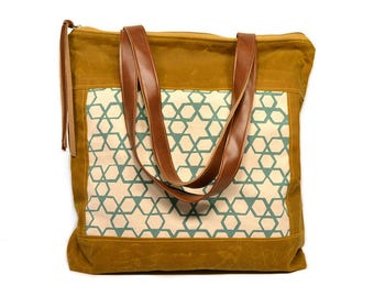 bucket tote • brown waxed canvas tote - geometric print • screenprinted aqua geometric print - brown waxed canvas  • zipper tote