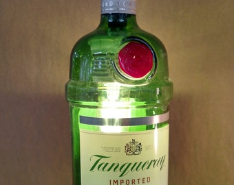 Hanging pendent light made with a recycled Tanqueray Gin bottle shade.