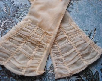 Wedding vintage 50s , pastel apricot nylon-shiffon-sheer gloves with a ruching. Made by Shalimer. Size 7 1/2