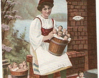 Lady with Babies, children in baskets,  colorized Vintage baby postcard, carte postale - curious postcard