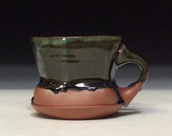 Small mug in dark copper green with glaze drips coffee mug