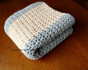 Blue and cream colored throw blanket