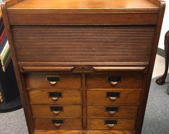 Antique Globe Oak Filing Cabinet Pull Down Door 16d28w34.5h Shipping is not free