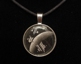 collage necklace - punched paper moon image with recycled soda pop can aluminum barcode stars