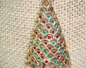 1960s MYLU Brand Red and Green Jeweled Christmas Tree pin.