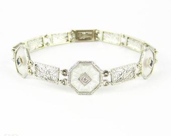 Art Deco Diamond Bracelet, Camphor Glass & Filigree Link White Gold Bracelet with Diamond and Blue French Cut Sapphires, Circa 1930s.