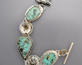 Facted Turquoise with a Diamond Flower