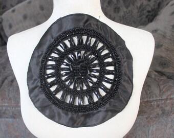 Black    color    beaded  applique  trim