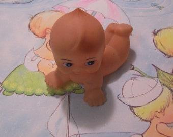 on the belly little cute kewpie doll
