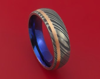 Damascus Steel Ring with 14K Rose Gold Inlay and Anodized Titanium Interior Sleeve Custom Made Band
