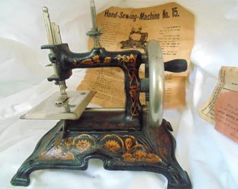 Muller 15. Germany. Sewing Machine. Childs. Antique. Crank Sewing Machine. Sewing Machine #15. w/ attachments. original paper instructions