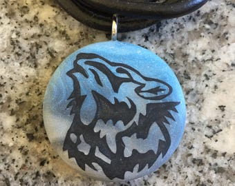 SKY Wolf pendant hand carved on a polymer clay blue/grey pearl color background.  Pendant comes with a FREE necklace.