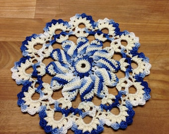 Cream variegated shades of blue Pinwheel Doily 7 inches round