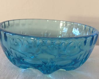 A small, vintage blue trinket dish