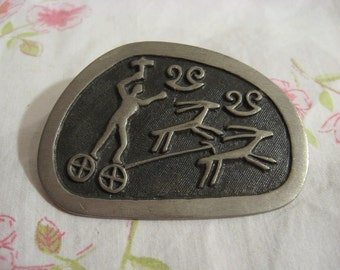 Signed, Modernist vintage Pewter brooch, Made in Sweden w raised chariot driver The kings Grave at Kivik