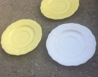 2 yellow and 1 white Federalist ironstone saucers