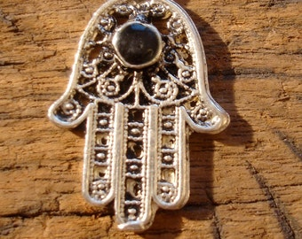 Moroccan small shiny black cut out filigree  hand pendant