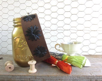 Delilah cuff. Brown leather cuff with three black flowers in vintage Swistraw by Ruby Buffalo.
