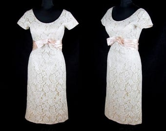 SPRING SALE 1950s Dress // Ivory Lace Wiggle Dress with Pink Satin Bow and Lining by Norman Original