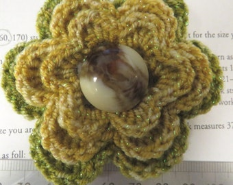 Irish crochet flower brooch in yellow and green wool with vintage button centre