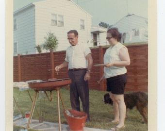 July 31 1966 Man Cooking Barbecue Vintage Snapshot Mid Century Modern Picnic Photo Back Yard Kitchen Memorabilia Color Photograph
