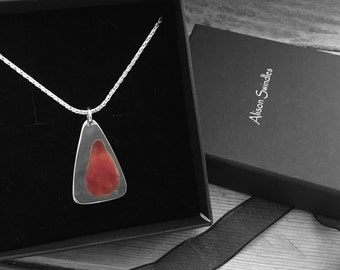 "Sterling silver pendant on an 18"" chain with shades of orange vitreous enamel."