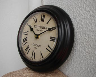 shabby chic,vintage style clock,small,round,metal,wall clock-battery operated,Victoria Station,London,Roman numerals printed face