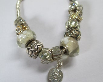 Jewelry  silver toned beaded bracelet with silver toned beads and rhinestone  glass beads
