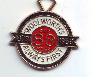 24 mm Woolworth's 80th Year Always First Charm Medal retail Exonumia 1879  1959 Enameled