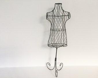 Handmade bodice sculpture. Jewelry display made of Metallic barb wire