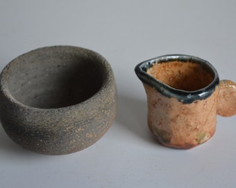 One sake cup and a small creamer jug, Japanese pottery