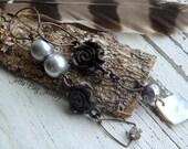 Old Roses- rustic metal roses. vintage rhinestone. black grey. asymmetrical dangle earrings. vintage mixed media jewelry . Jettabugjewelry