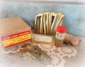 file drawer card holders / set of 28 brass label holders in original box / vintage industrial supplies / library card file hardware / NOS