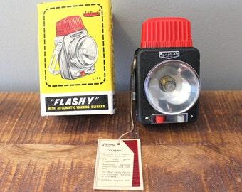"Vintage AshFlash ""FLASHY"" light, New Old Stock, Rare black, 1960"