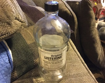 Vintage Listerine bottle with front and back label