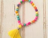Neon magnesite beaded bracelet with fluffy bright yellow tassel; tassel bracelet; boho chic bracelet