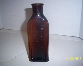 1920's Father John's Medicine Lowell, Mass 7 3/8  inch amber medicine bottle No 2