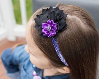 Black Dahlia and purple satin rosette purple rhinestone center on purple glitter stretchy headband