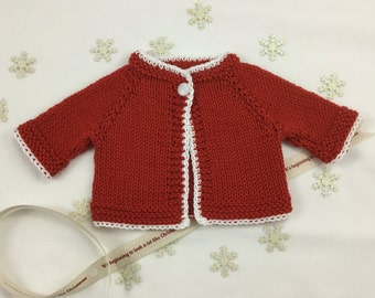 "Christmas Waldorf Doll cardigan in red (fits 14"" doll)."