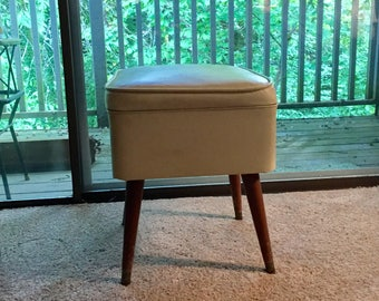 Mid Century Modern stool with storage tapered wood legs off white vinyl bench stool seat ottoman