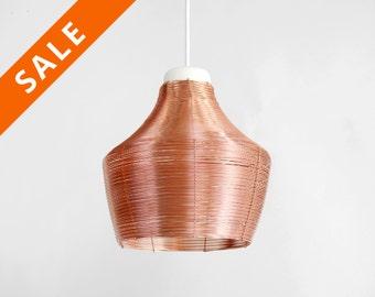 koperen lamp hoge hanglamp van metaal half transparant