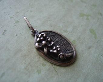 A Vintage Silver Pendant - Flower Motif.