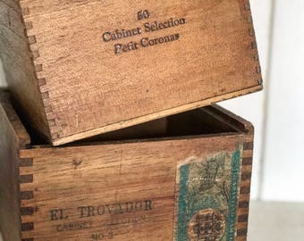 A pair of beautiful vintage advertisement boxes