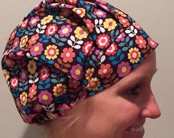 Floral • bouffant hat with adjustable elastic fastener.