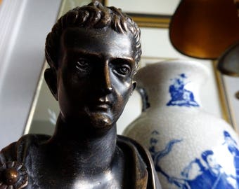 small bust of Augustus Caesar on plinth